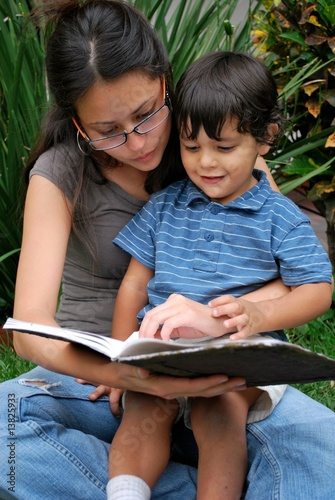 Young mother reading to her toddler