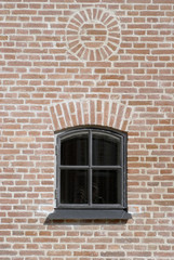 Brick wall with vintage window