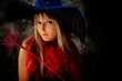 blond teenage girl with wizard hat and magical wand