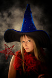 blond teenage girl with wizard hat and wand