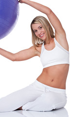 Fitness series - Young woman with purple ball