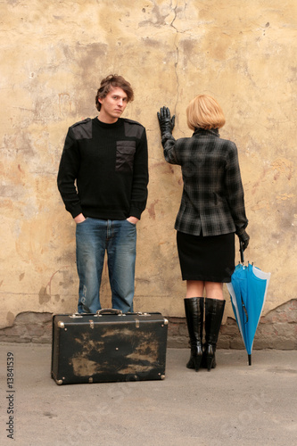 Man, woman and suitcase