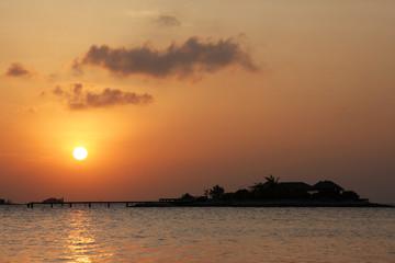 Small maldivian resort at sunset