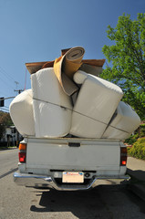 Truck overflowing with furniture
