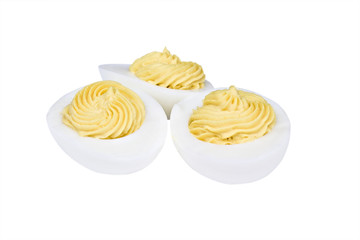 Deviled eggs sprinkled with paprika isolated on white.