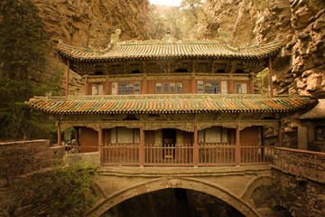 ancient traditioal temple over a canyon. images from old China