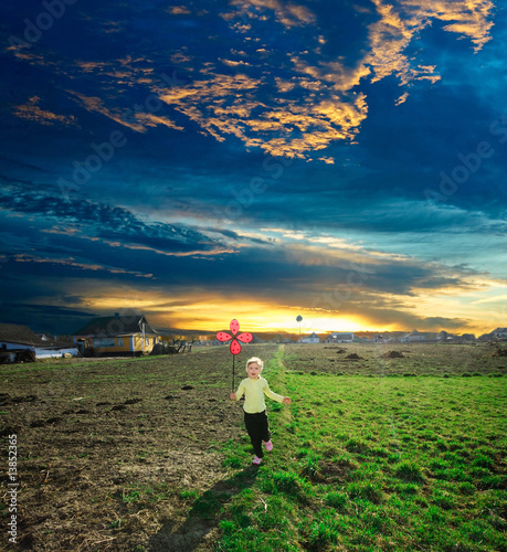 A girl running on a background of a sunset