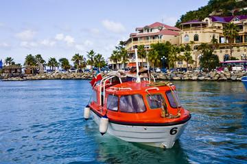 Orange Lifeboats Across Colorful Bay