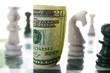 american twenty dollar bill on a chess board