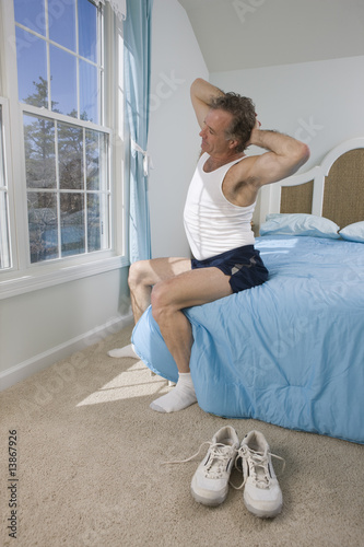 Mature man getting out of bed