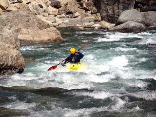 yellow kayak on the rapids