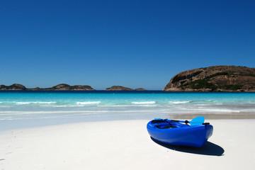 Blue canoe on a sandy beach