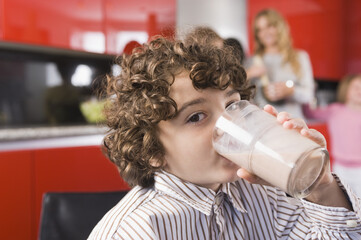 Portrait of a boy drinking a glass of milk