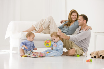 Parents with their son and a daughter in a living room