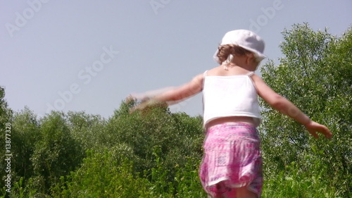 dancing little girl outdoor