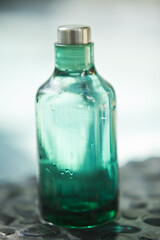 Close-up of an empty bottle of aromatherapy oil