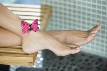 Butterfly on a woman's leg