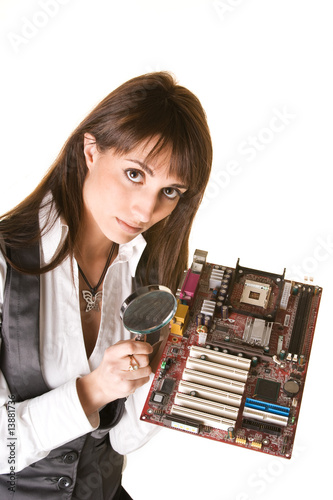 Attractive woman with motherboard solving hardware problem