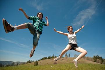 Teen couple jumping