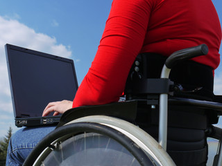 Handicapped woman with laptop