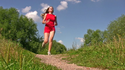 sport woman in red running in park