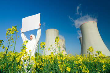 Man with sign at nuclear plant