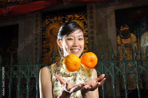 Woman Holding Oranges