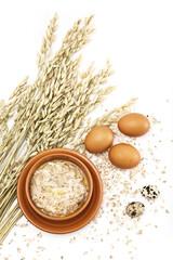 Served place setting: Hot morning porridge and eggs on white bac