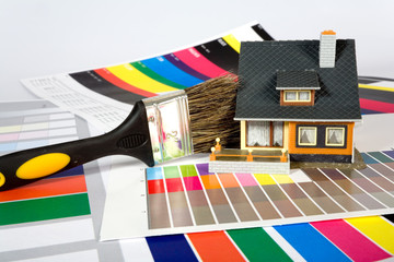 Colouring of the  house by a paint.