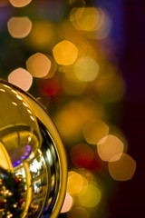 Gold Ornament and Christmas Lights