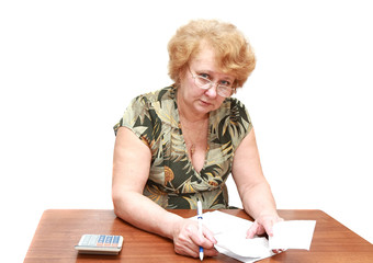 Senior lady write down on flat rent bills. Isolated