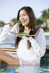 Woman eating seaweed with chopsticks
