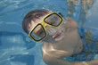 Child with goggles in a pool