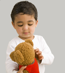 Handsome Toddler Playing with a Teddy Bear