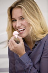 Woman eating a mushroom shaped candy