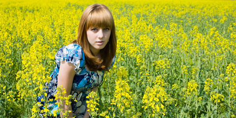 Blonde in a rape field