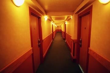 A narrow hallway in a hotel