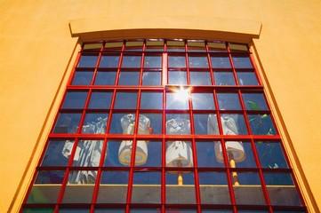 Window display of dressed tailors' dummies