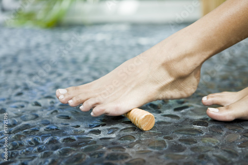 Woman massaging her foot with a foot roller
