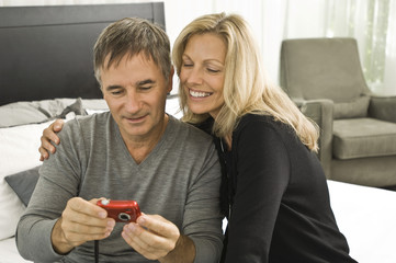 Couple looking at a digital camera
