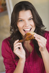 Woman eating chicken