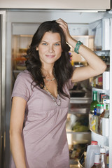 Woman standing in front of a refrigerator