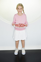 Girl holding a plate of jelly beans