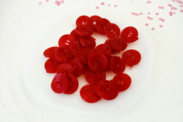 Pile of red spiral candies on a table
