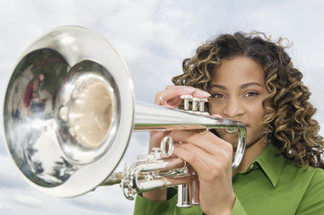 Portrait of a girl playing a trumpet