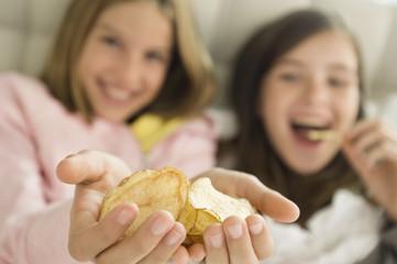 Girl holding potato chips in her hands