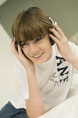 Boy listening to headphones