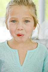 Portrait of a girl eating a candy