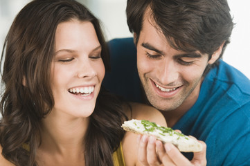 Couple eating bread and smiling