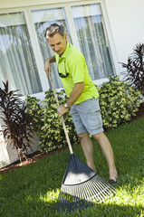 Man raking the lawn